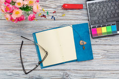 Stationery, flowers and notepad Royalty Free Stock Photography