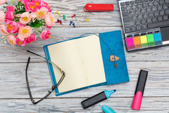 Stationery, flowers and notepad Royalty Free Stock Photo