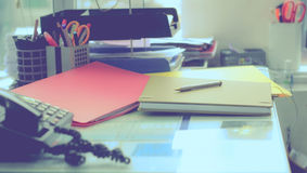 Stationery,focused on pen in Blurred background workspace Royalty Free Stock Photo