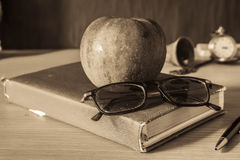 Stationery and fruits on desk. Royalty Free Stock Photography