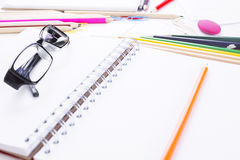 Stationery and glasses closeup Royalty Free Stock Image