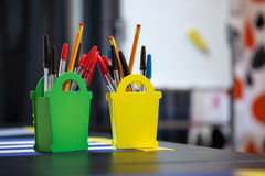 Stationery goods in organizer at table, copyspace Royalty Free Stock Images
