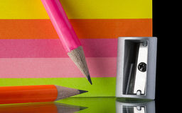 Stationery items. Stationery. colored pencils, sharpener and paper for notes, close-up Stock Images