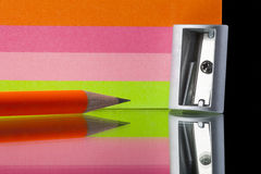 Stationery items. Stationery. colored pencils, sharpener and paper for notes, close-up royalty free stock photo