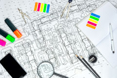 Stationery items lie on the drawing Stock Photos