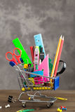 Stationery items in shopping trolley vertical Royalty Free Stock Photos