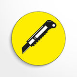 Stationery knife. Vector icon. Black-and-white object on a yellow background. Stock Photos