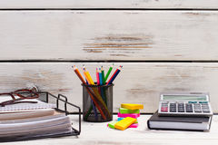 Stationery lie on the old boards. Stock Photography