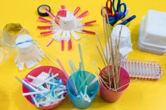 Stationery materials for activities with children. Straws, felt. Tip pens, scissors, sticks in colored boxes for the construction of games and experiments royalty free stock photos