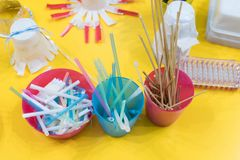 Stationery materials for activities with children. Straws, felt. Tip pens, scissors, sticks in colored boxes for the construction of games and experiments stock images