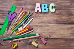 Stationery objects. With word abc on wooden background Royalty Free Stock Images