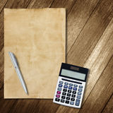 Stationery office equipment and paper on wooden background Royalty Free Stock Photo