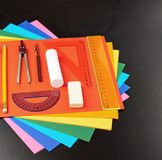 Stationery over the colorful sheets Stock Photography