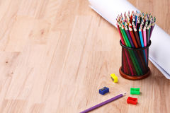Stationery and paper on the table. Plank table with accessories to study. The lesson. Stock Photos