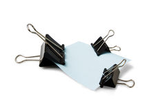 Stationery pins and a sheet of paper. On a white background Stock Photography