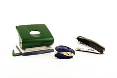 Stationery - punch, stapler and anti-stapler on white background Royalty Free Stock Photos