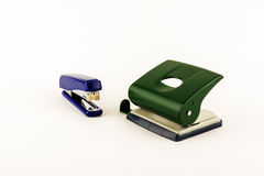 Stationery - punch and stapler on white background Stock Photography