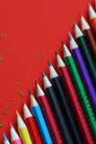 Stationery red background. Stationery on colored background set of pencils and various devices Royalty Free Stock Image