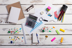Stationery scattered on a wooden background. Royalty Free Stock Images