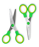 Stationery scissors with green handles on a white isolated background Royalty Free Stock Photography