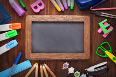 Stationery set frame on wood table Royalty Free Stock Photos