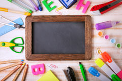 Stationery set frame on wood table Royalty Free Stock Images