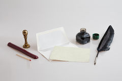 Stationery set. Paper with envelope, quill pen, inkwell and seal Royalty Free Stock Photography