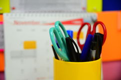 Stationery set standing in a container over blur background royalty free stock photography