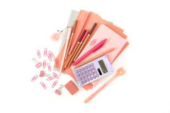 Stationery stack . Back to school. Paper sheets notepad pencils pen eraser clips calculator royalty free stock photography