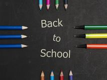 Back to school scenery. Stationery of student are on a black board Royalty Free Stock Photography