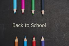 Back to school scenery. Stationery of student are on a black board Stock Photos