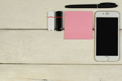 Stationery, sunglasses, telephone, flash memory cards on a wooden table Royalty Free Stock Photography