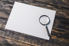 Stationery on a table. Office devices on a wooden table in studio Royalty Free Stock Photography