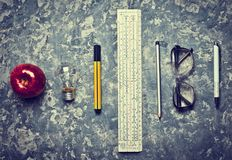 Stationery tools for the education of engineering students. Workspace on a concrete background. I have an idea! Ruler, marker, pencil, pen, glasses, apple stock image
