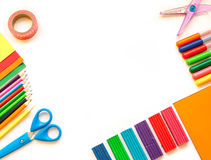 Stationery on the white background. Multicolor pencils and crayons. Place for your text Stock Photos