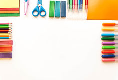 Stationery on the white background. Multicolor pencils and crayons. Place for your text Stock Images