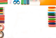 Stationery on the white background. Multicolor pencils and crayons. Place for your text Stock Photo