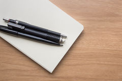 Stationery. With white book on table Royalty Free Stock Photos
