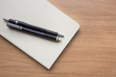 Stationery. With white book on table Royalty Free Stock Photography
