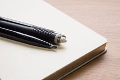 Stationery. With white book on table Stock Photo