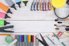 Stationery on a white wooden background. stock illustration