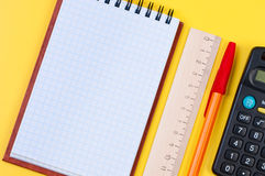 Stationery on yellow background. Stock Image