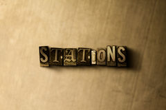STATIONS - close-up of grungy vintage typeset word on metal backdrop Royalty Free Stock Photography