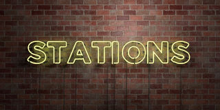 STATIONS - fluorescent Neon tube Sign on brickwork - Front view - 3D rendered royalty free stock picture Stock Image