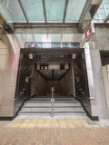 Stationsutgång A2 - förlängningen för MTR Sai Ying Pun av ölinjen till det västra området, Hong Kong Royaltyfri Bild