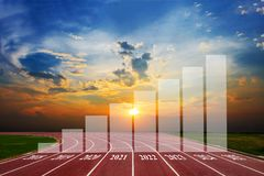 Statistical columns of chart shows the growth of the business. From 2018-2025 Running Track on the morning sunset royalty free stock photos
