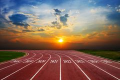 Statistical columns of chart shows the growth of the business. From 2018-2025 Running Track on the morning sunset stock photography