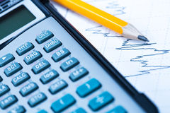 Statistical graphs and calculator Royalty Free Stock Images