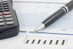 Statistical information. Image of statistical information with calculator and pen Royalty Free Stock Photos