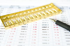 Statistical report. Gold abacus and statistical report royalty free stock photos